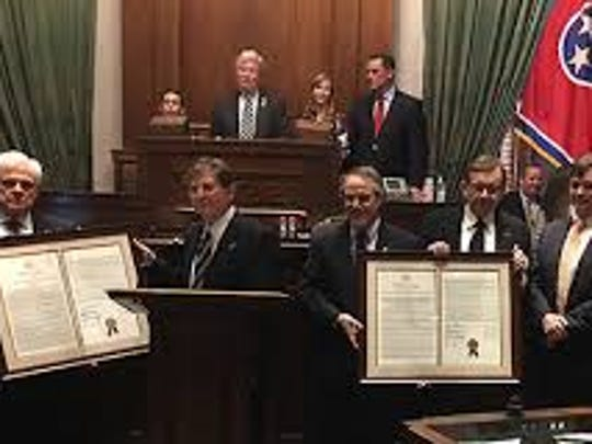Tennessee lawmakers display proclamations.