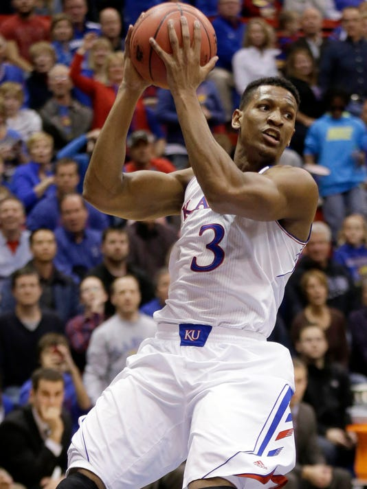 ADVANCE FOR WEEKEND EDITIONS, NOV. 5-6- FILE - In this Nov. 22, 2013, file photo, Kansas' Andrew White III grabs a rebound during the first half of an NCAA college basketball game against Towson in Lawrence, Kan. White began his college basketball career at Kansas, played a season at Nebraska and will wrap it up at Syracuse. (AP Photo/Charlie Riedel, File)