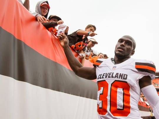 Cleveland Browns cornerback Jason McCourty (30) high-fives fans after the game against the New York Jets on Oct 8 at FirstEnergy Stadium.
