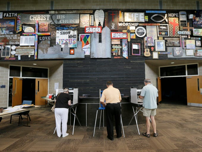 Voters fill out their primary ballots in precinct 112 on June 3, 2014, in West Des Moines, Iowa.