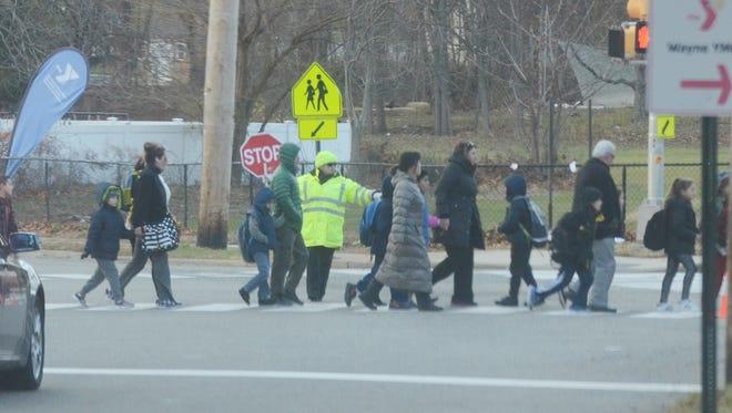 John F. Kennedy Elementary School children crossing Ratzer Road on Nov. 22, 2016. Wayne schools do not offer full day kindergarten, one of the few in the state.