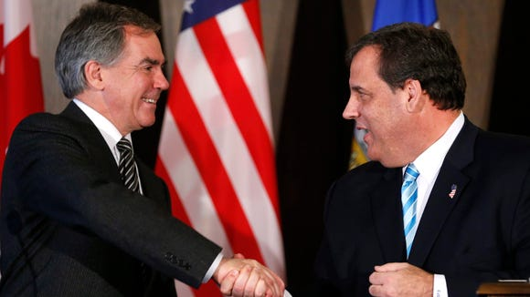 Gov. Chris Christie, right, shakes hands with Alberta Premier Jim Prentice during a meeting in Calgary, Alberta, Canada on Thursday, Dec. 4, 2014. (AP Photo/The Canadian Press, Larry MacDougal)