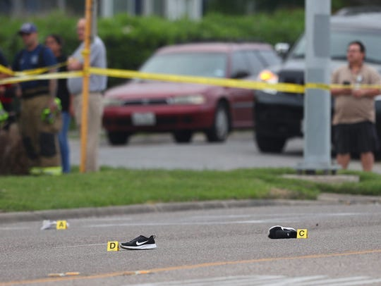Black shoes lay in the roadway after a hit-and-run