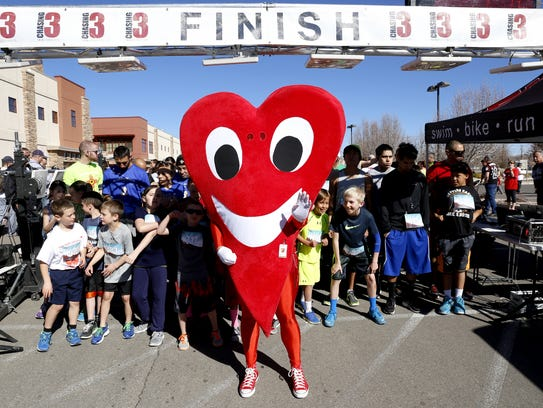 Led by hospital mascot Mr. Juan Hart, runners line