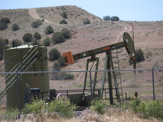 A pumpjack operates in Farmington. State sales of oil