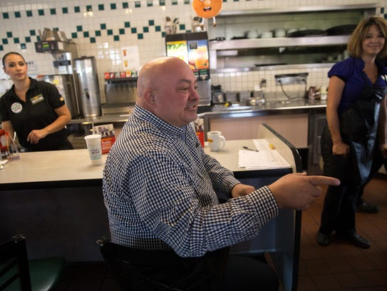 Denny's district leader Jim Coulter talks with employees