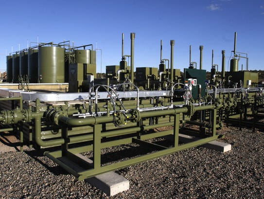 An oil and gas production site is pictured, Monday, Nov. 3, 2014, in Lybrook.