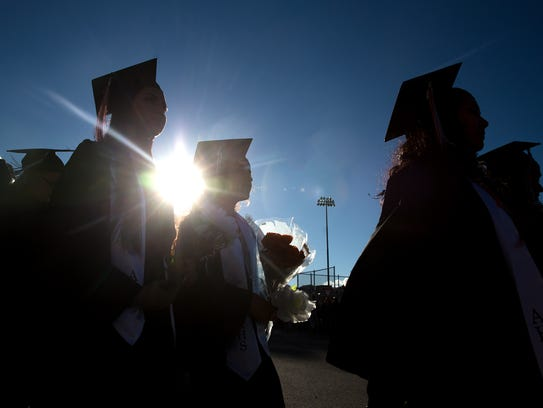 Aztec High School held its commencement ceremony at Fred Cook Memorial Stadium. Requirements for future grads are under review in  several school districts.