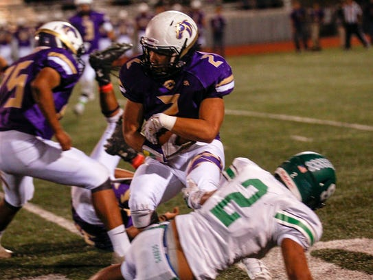 Kirtland Central's  Jaeden Alfred carries the ball