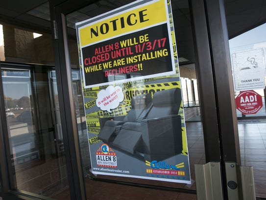 A sign offers a description of some of the changes afoot at the Allen 8 movie theater in Farmington.