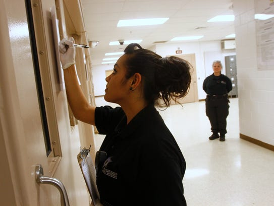 Officer Perez checks on patients Jan. 8, 2016, at the San Juan County Adult Detention Center in Farmington.