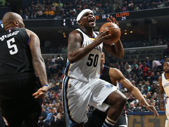 Memphis Grizzlies Zach Randolph, center, breaks through the defense of Los Angeles Clippers Marreese Speights, left, and Wesley Johnson, right,. at FedExForum.
