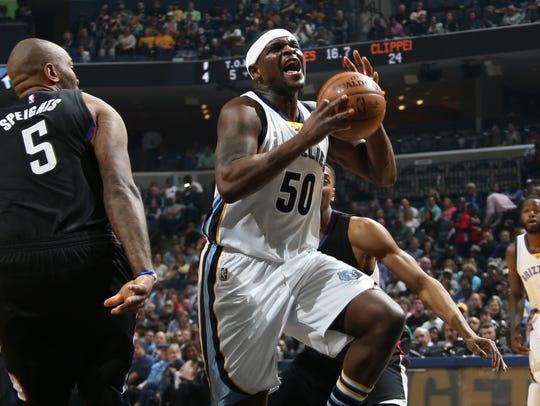 Memphis Grizzlies Zach Randolph, center, breaks through