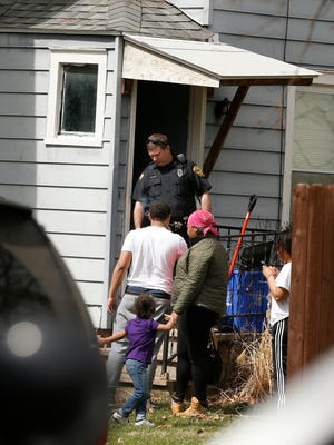Elmira police exit an apartment on the 500 block of South Avenue on the city's Southside just before 1 p.m. Tuesday. Several reports of shots fired near the intersection of Mount Zoar and Broadway streets at around noon led officers to the apartment.
