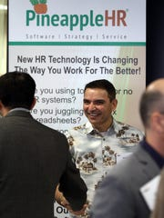 Neil Jesani, cofounder and CEO of Freehold Township-based PineappleHR, talks up his company's human resources software during the Venture Conference hosted by the New Jersey Tech Council in Woodbridge.