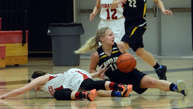 Hartland's Natalie Halonen (seated) comes up with the ball after stealing it from Pinckney's Shannon Dingman (lying on the floor) during Tuesday's contest. Pinckney's Jackie Kolnitys (12) and Hartland's Michelle Moraitis look on. The Eagles went on to take a 41-24 victory.