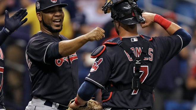 Cleveland Indians' Edwin Encarnacion, left, and catcher Yan Gomes celebrate after the team defeated the Tampa Bay Rays 2-0 during a baseball game, Tuesday, Sept. 11, 2018, in St. Petersburg, Fla. (AP Photo/Chris O'Meara)