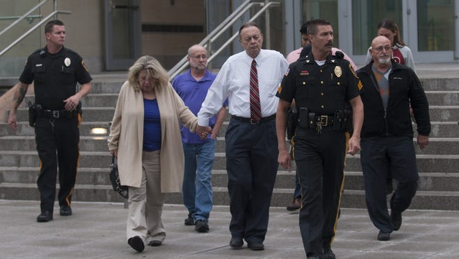 James Stuart's parents, center,  along with other friends and family members get escorted out  by police after a guilty verdict was reached Thursday at the Gloucester County Justice Complex in Woodbury.
