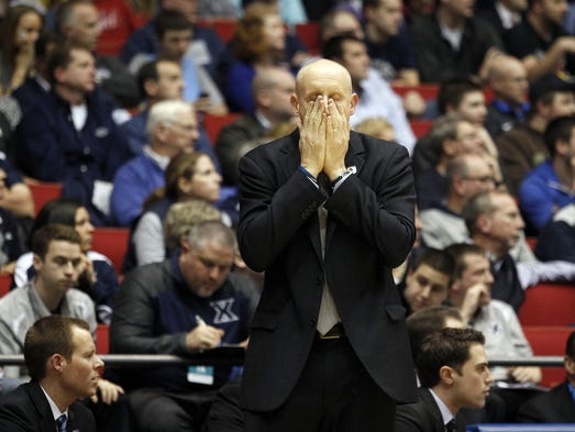 Xavier head coach Chris Mack reacts as his team his loses to NC State.