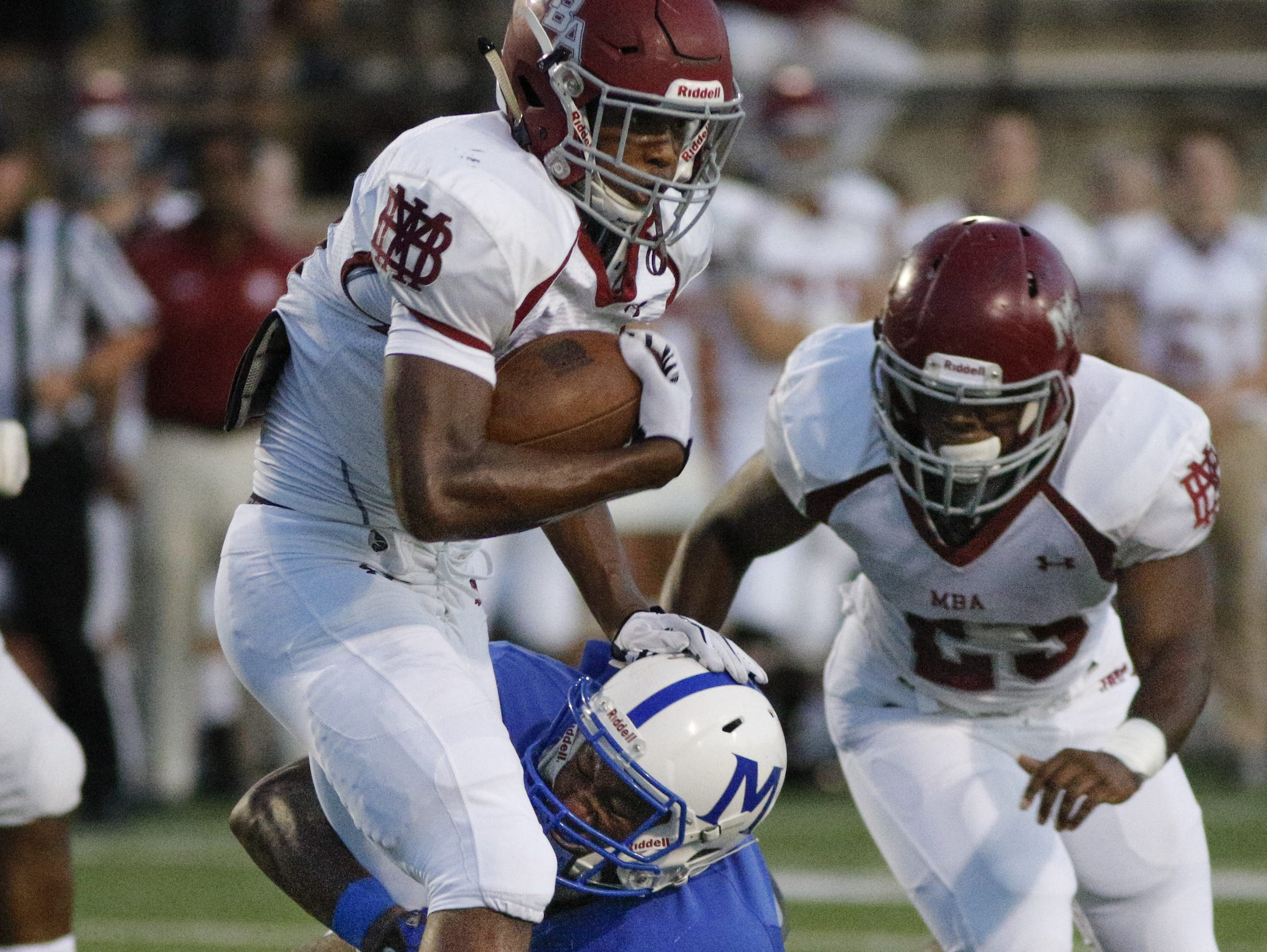 MBA running back Ty Chandler (left) breaks free from a McCallie defender during last week's 33-27 overtime win.