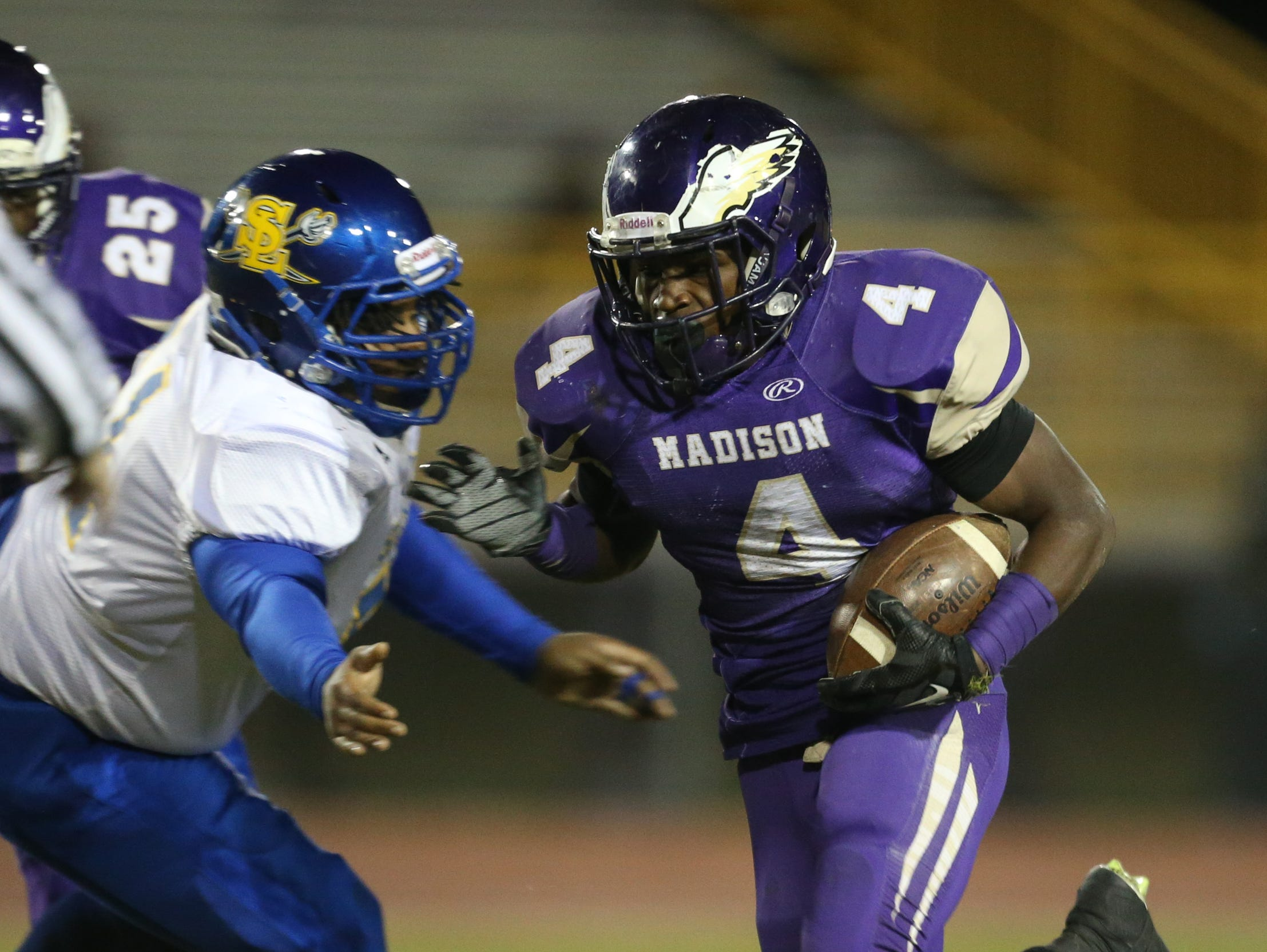Madison Heights Madison high schools Lance Mitchell runs the ball against South Lake high school during first half action Friday, October 16, 2015 in Madison Heights Michigan.