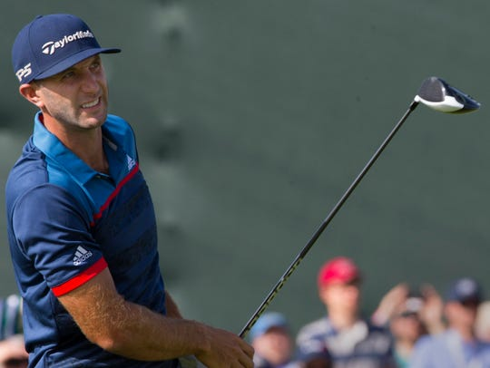 Dustin Johnson tees off on the 10th hole during the
