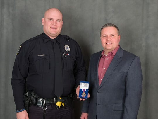 Officer Luke Schauer is awarded the Sioux Falls Police