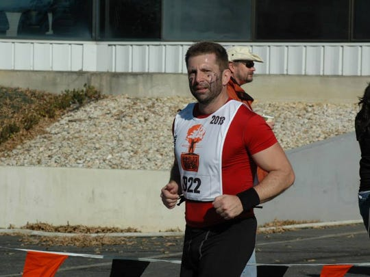 Tallahassee resident Patrick Slevin competes in the 2013 World's Toughest Mudder in New Jersey.