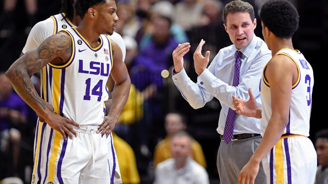 LSU coach Will Wade talks with players, including guards Marlon Taylor (14) and Tremont Waters (3), during the first half of an NCAA college basketball game against Arkansas on Saturday, Feb. 2, 2019, in Baton Rouge, La. (AP Photo/Bill Feig)
