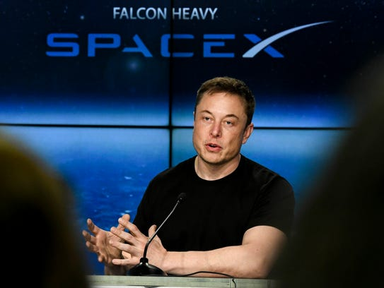 Elon Musk, CEO of SpaceX answers questions during a