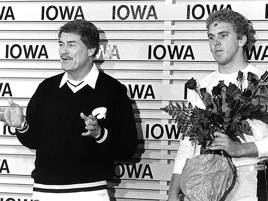 Coach Hayden Fry and Chuck Long talk after Iowa clinched