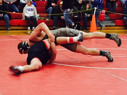 Clear Fork's Rick Thomas works toward a pin of Crestview's