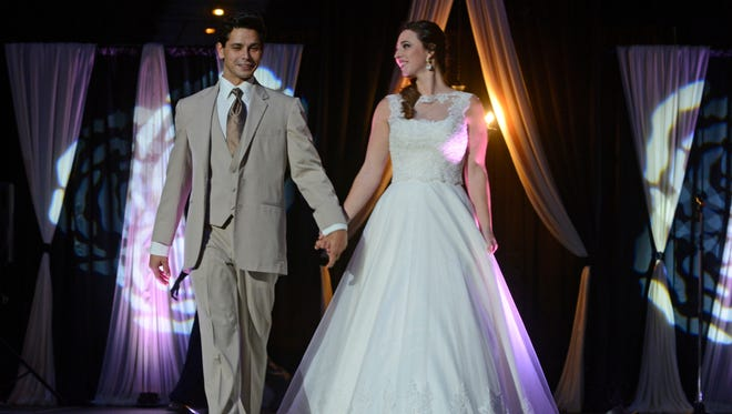 Models show off the latest wedding fashions during the 2016 Beautiful Beginnings Bridal Expo at the Pensacola Bay Center.