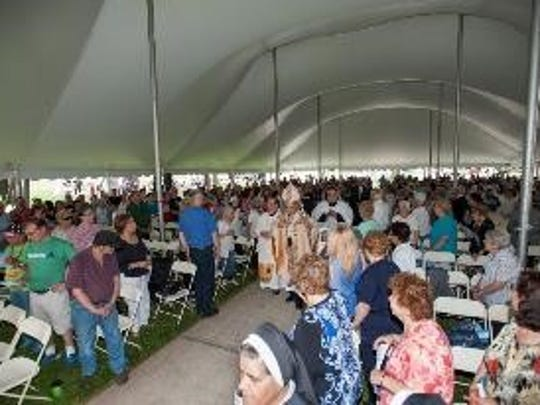 People gather to celebrate Memorial Day Mass last year.
