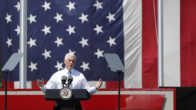 Vice President Mike Pence speaks to workers Tuesday at Winnebago Industries in Forest City.