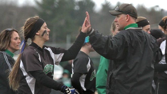 Clear Fork softball coach Jeff Gottfried high-fives Zara Thomas after his 400th career win in 2018.