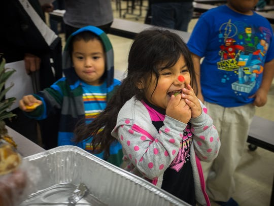 Five-year-old Eliannah Herrera delights in eating some