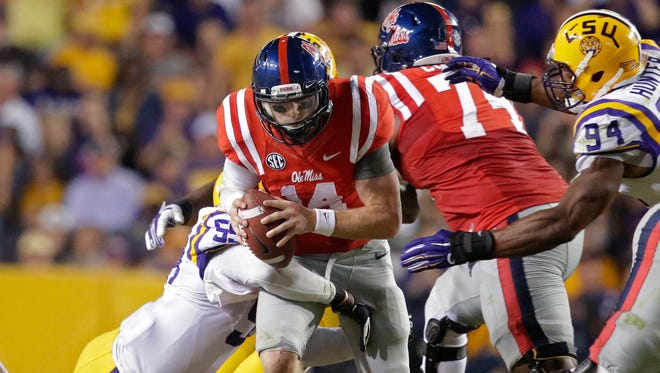 Ole Miss quarterback Bo Wallace (14) is sacked in LSU's 10-7 win over the Rebels on Saturday. Wallace threw for 176 yards, a touchdown and interception.