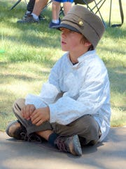 A military waif listens to music at the Fort Stanton Live event Saturday.