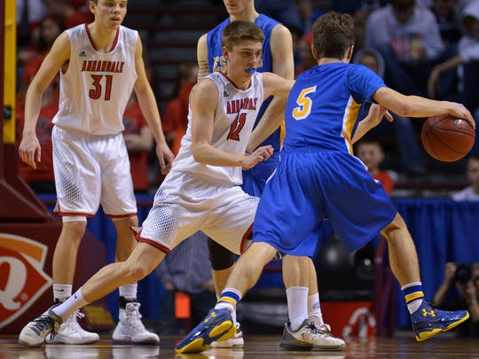 Annandale's Brad Weege (12) defends Esko's Trenton Menor (5) on a drive toward the net during the first half of the Class 2A boys state basketball tournament quarterfinal game Wednesday at the University of Minnesota's Williams Arena in Minneapolis.