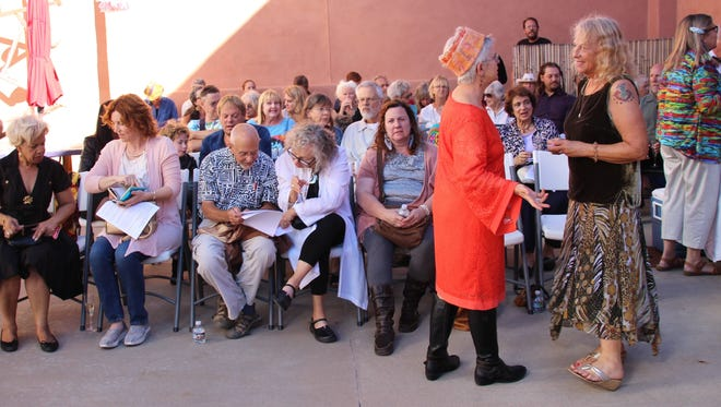 A crowd gathers and waits for  a fashion show that was part of the Red Hot, Red Dot Art Festival in Silver City.
