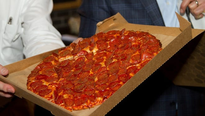The pepperoni pizza from Donatos Pizza, which opened a location in Midtown on Monday