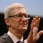 Apple CEO Tim Cook attends the inauguration of the academic year at the Bocconi University, in Milan, Italy, Tuesday, Nov.10, 2015. On a trip to Europe that coincided with the sales start for Apple's iPad Pro, Cook questioned why anyone would buy a PC.