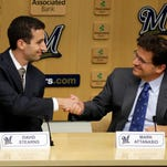 Milwaukee Brewers  Principal owner Mark Attanasio shakes hands with new  general manager David Stearns.