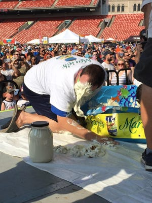 Matthew Tremblay spits out a wing he had bobbed out of blue cheese at the National Buffalo Wing Festival.