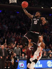 South Carolina Gamecocks guard Duane Notice (10) dunks the ball against Florida Gators guard KeVaughn Allen (5) during the second half in the finals of the East Regional of the 2017 NCAA Tournament at Madison Square Garden.