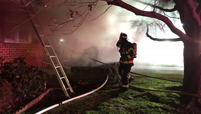 A 68-year-old woman was seriously injured Sunday during a house fire south of Elsmere, officials said.