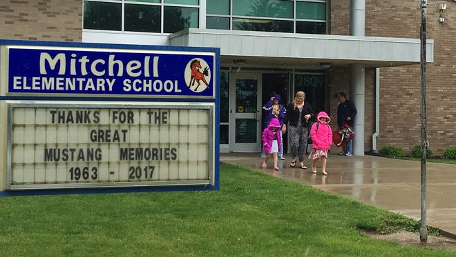 Students and parents leave Mitchell Elementary School on Wednesday, the last day of classes in 2017. The school was one of three in Muncie closed after the 2016-17 school year because of declining enrollment.