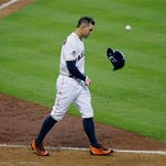 Houston Astros' George Springer tosses his helmet after striking out to end the eighth inning during Game 4 of baseball's American League Division Series against the Kansas City Royals, Monday.
