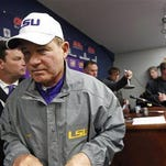 LSU head coach Les Miles leaves a media availability with reporters following the Ole Miss game.